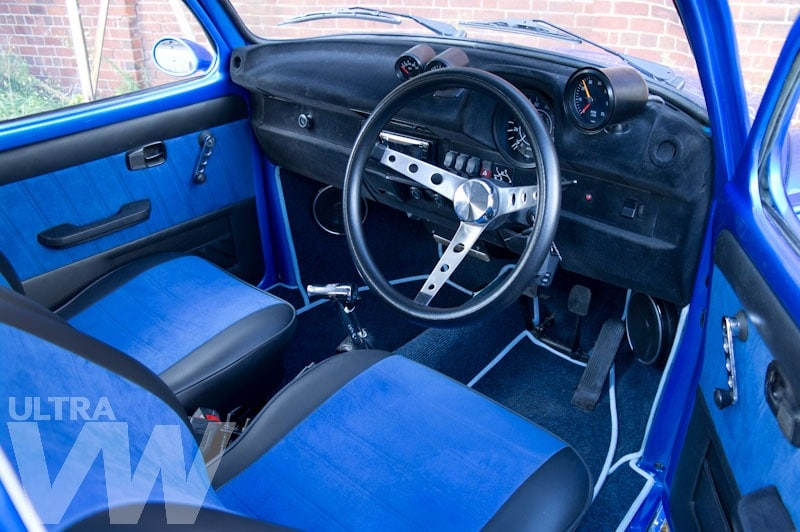 inside restoration of blue Beetle - steering wheel - leather seats