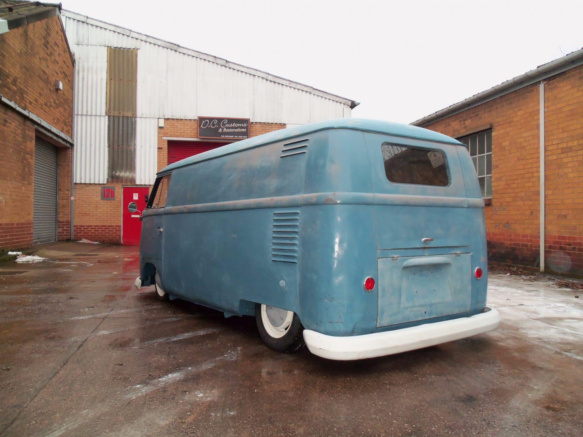 VW blue camper van - rear view