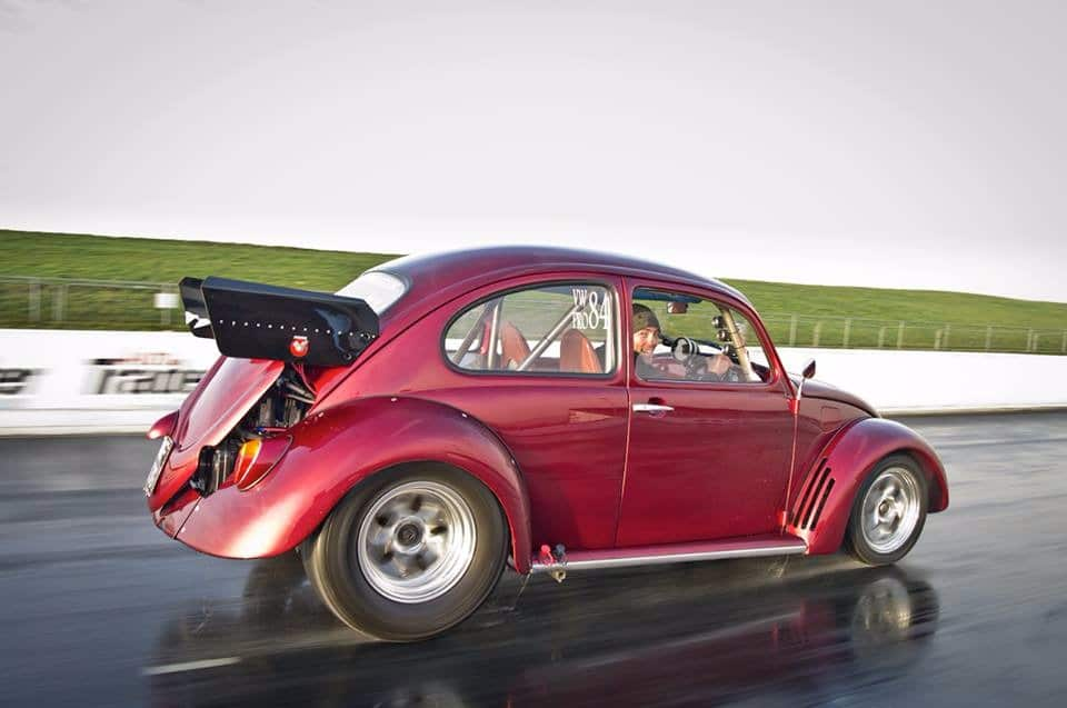 red restored Beetle on track driving