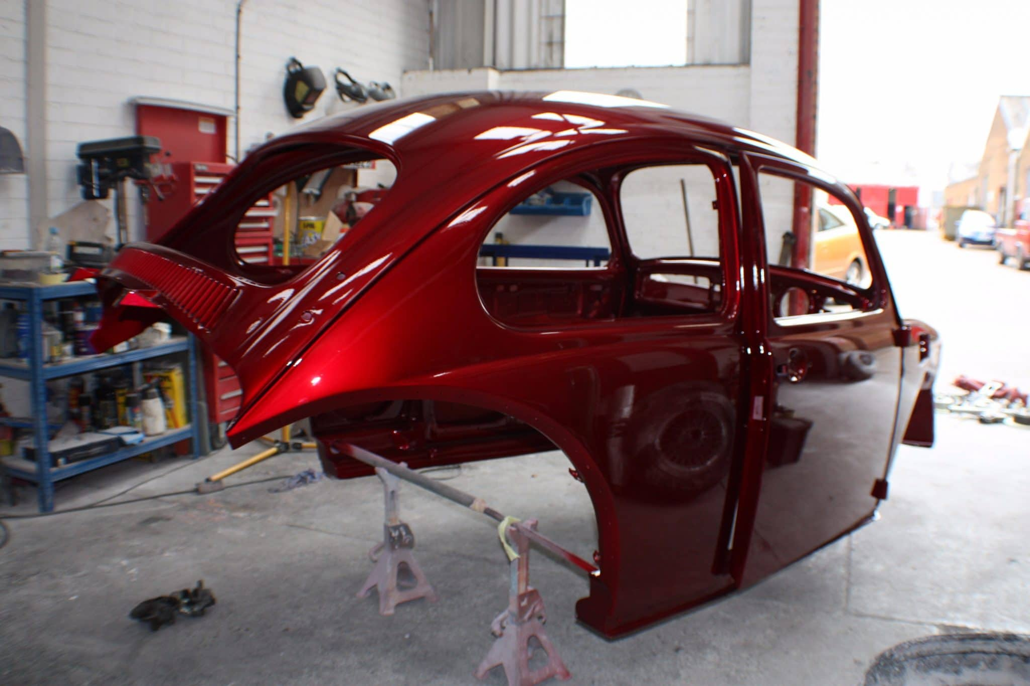 red ppf Beetle shell in workshop