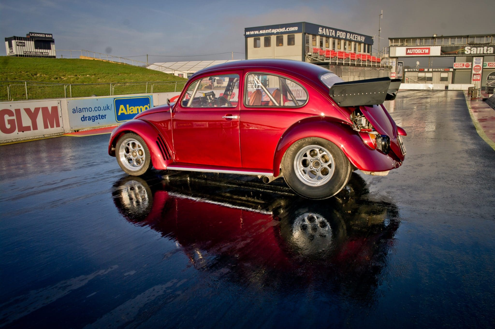 red restored Beetle on race track