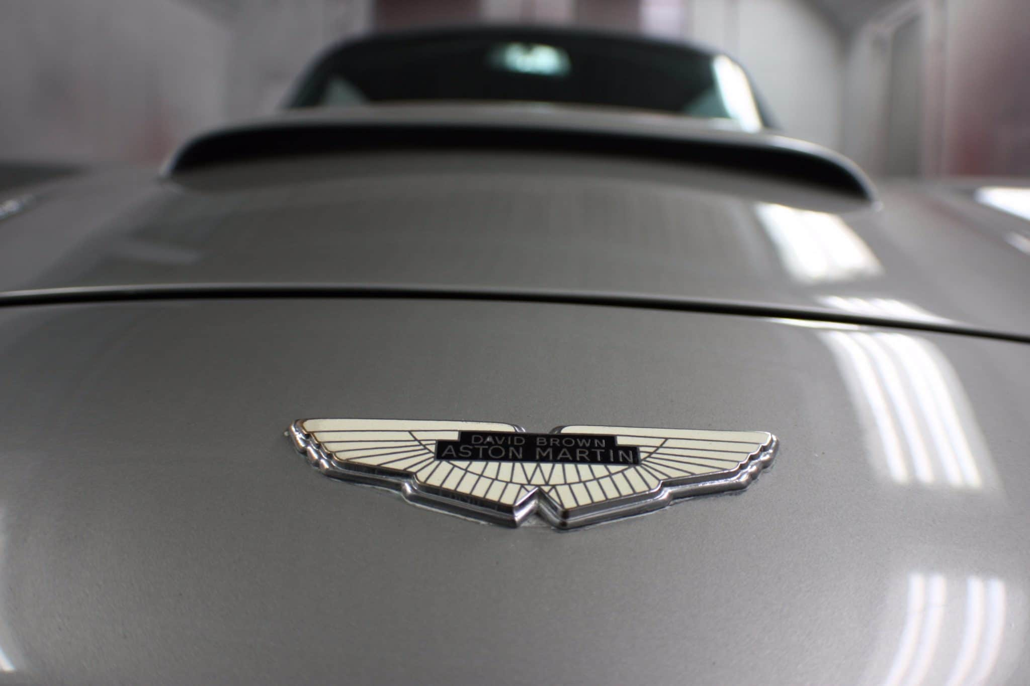 close up of Aston Martin badge
