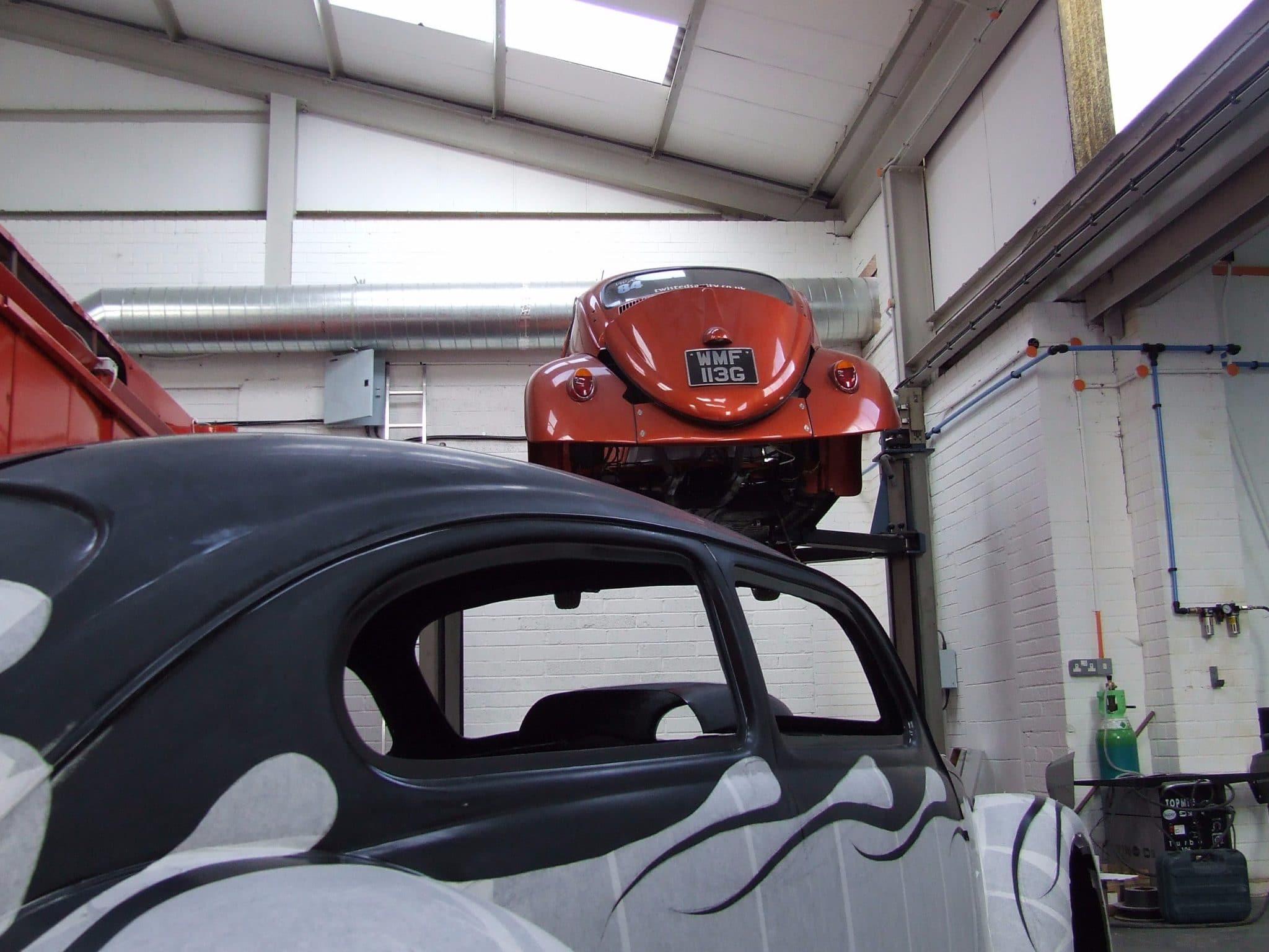 Beetle restoration - orange on ramp black and white on ground
