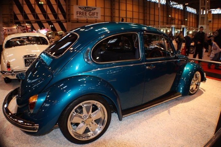 back view candy blue Beetle in show
