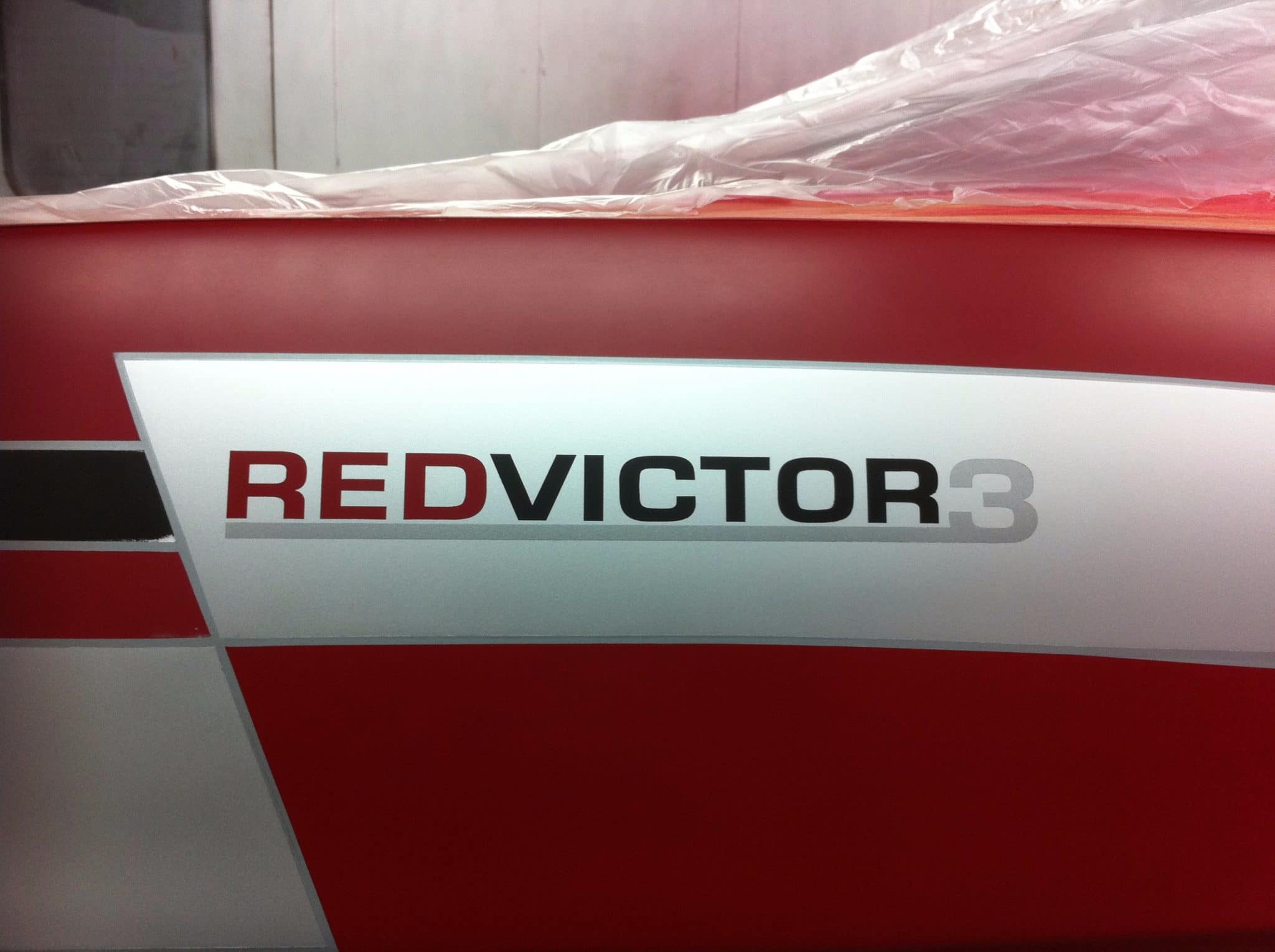 red victor 3 close up of of sign
