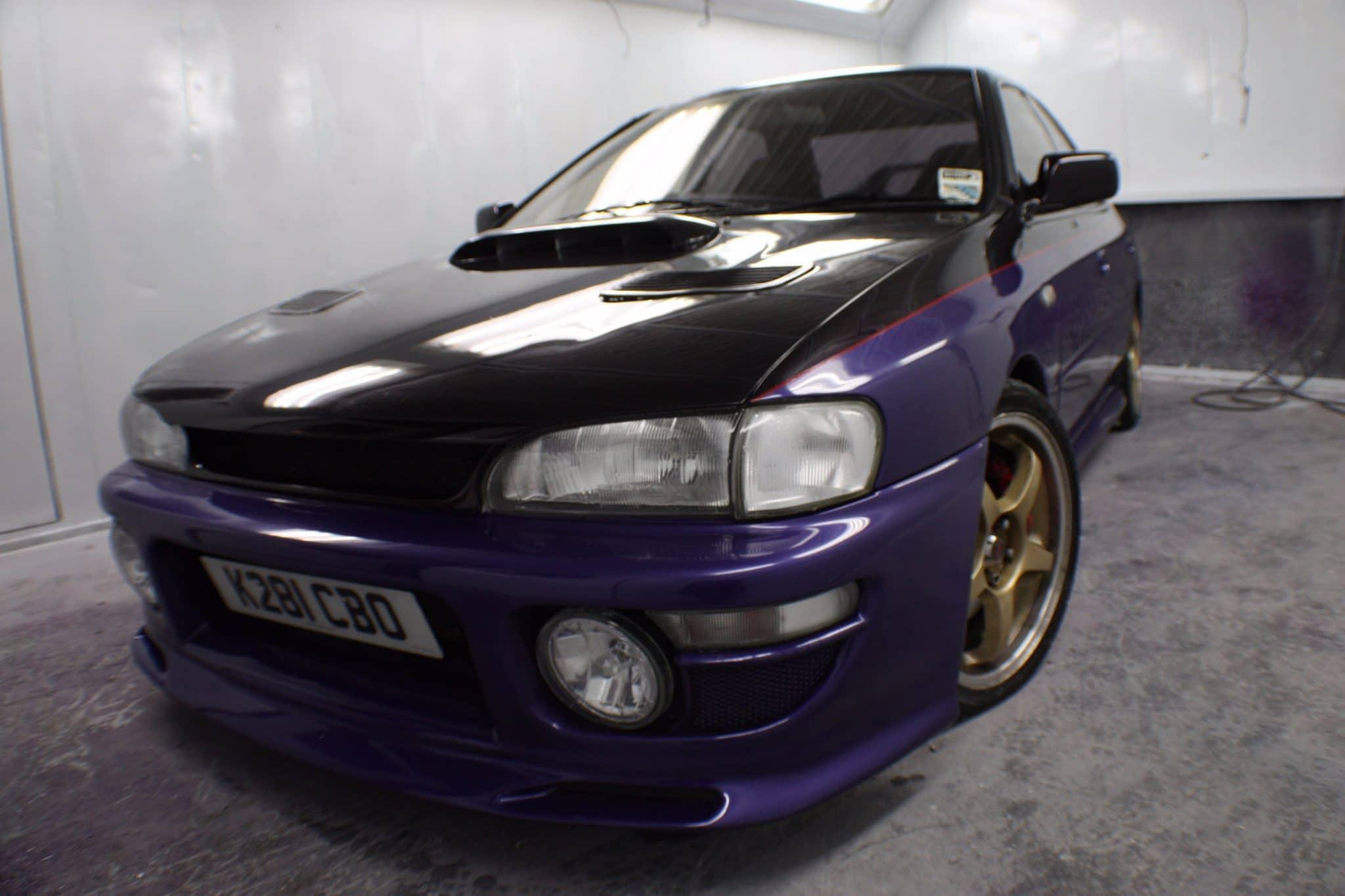 purple subaru side view